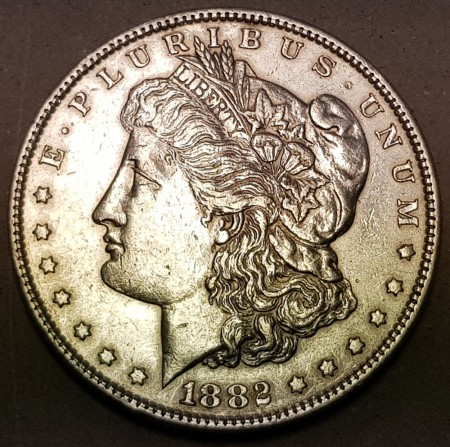 Morgan dollar 1882 kv. 1/1+